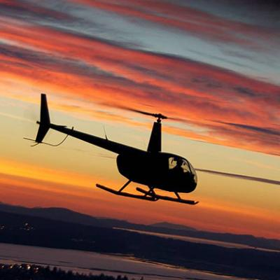 Coucher du soleil helicoptere robinson r44